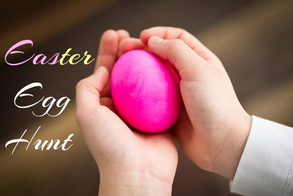 "A child's hands holding a pink egg with the words ""Easter Egg Hunt""."