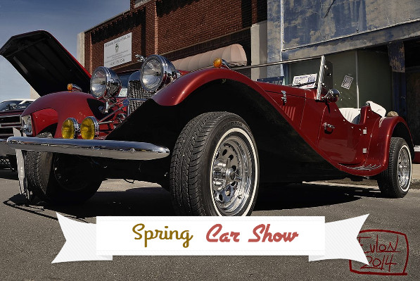 "Classic car with ""Spring Car Show"" banner."
