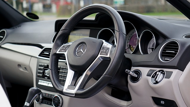 Car steering wheel and dashboard.